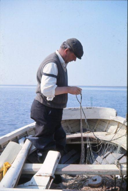 Fisherman Thomas (Tom) Gardner mending a haaf net