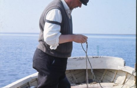 Fisherman Thomas (Tom) Gardner mending a haaf net