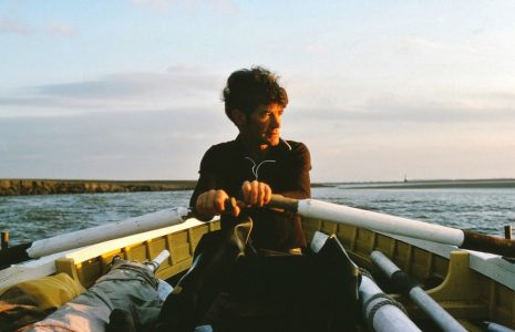 Fisherman Tom Smith rowing
