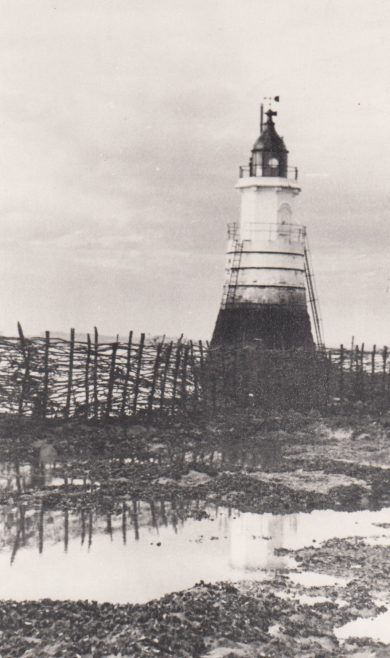 Plover Scar Lighthouse surrounded by a wattle fencing fish trap   Bob Parkinson