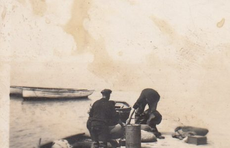 John Baxter working on his fishing boat at a jetty off Morecambe.