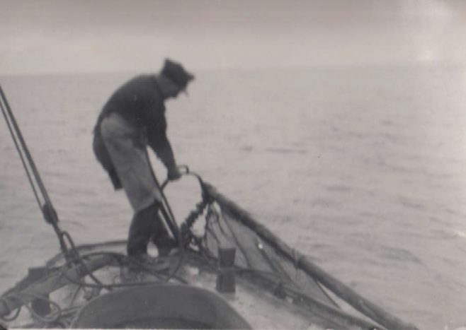 John Baxter aboard his fishing boat, LR 22, named Connie Baxter,hauling nets during a fishing trip in Morecambe Bay | Baxter Family