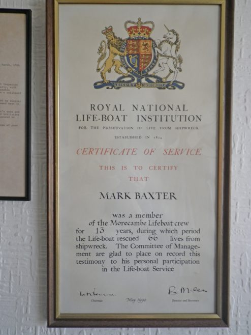 A certificate of service issued by the RNLI to Mark Baxter for his service with the Morecambe lifeboat of thirteen years and the rescue of 66 lives. | Baxter Family