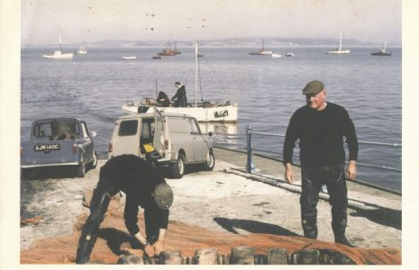 Samuel Baxter (Right) on the stone Jetty, Morecambe attending to fishing gear with LR 151 in the backgrouns.