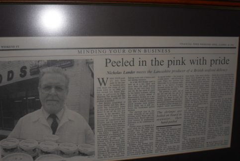 "Photo of newspaper article entitled ""Peeled in the pink with pride"""