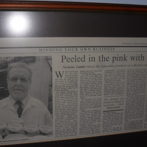 """Photo of newspaper article entitled """"Peeled in the pink with pride"""""""
