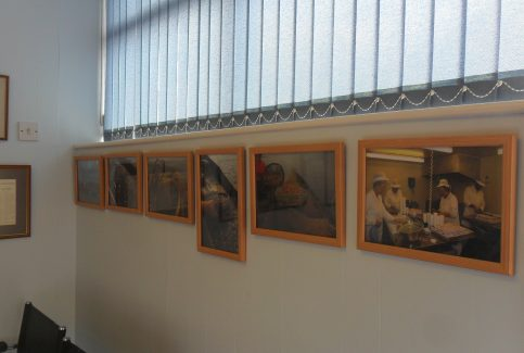 Baxter's fish shop interior showing wall with 6 framed  photos