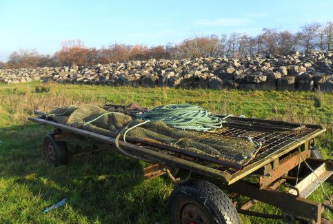 Photo of trailer loaded with fishing nets and rope at Flookburgh Bay.