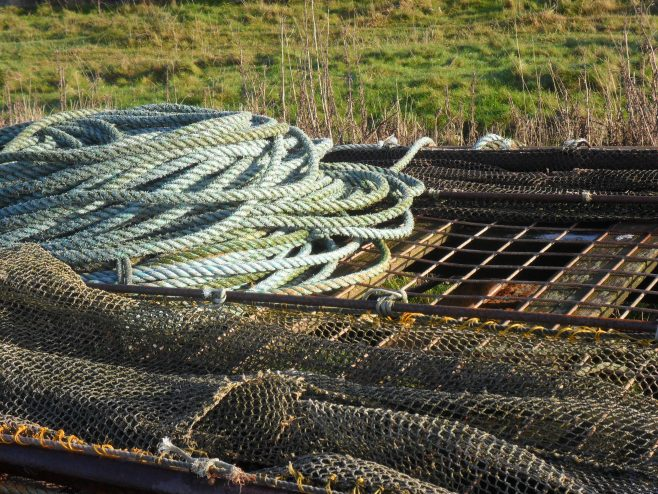 Close-up photo of trailer loaded with fishing nets and rope at Flookburgh Bay.