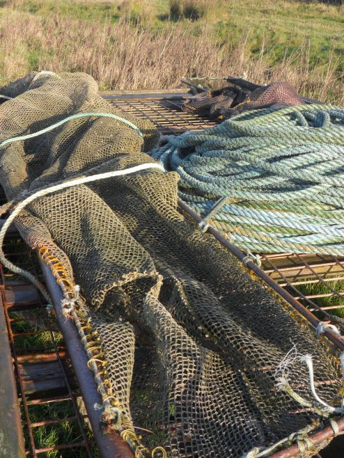 Photo of trailer loaded with fishing nets and rope at Flookburgh Bay, seen from different angle.