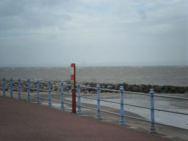 View of the sea and breakwater from the promenade at Morecambe.