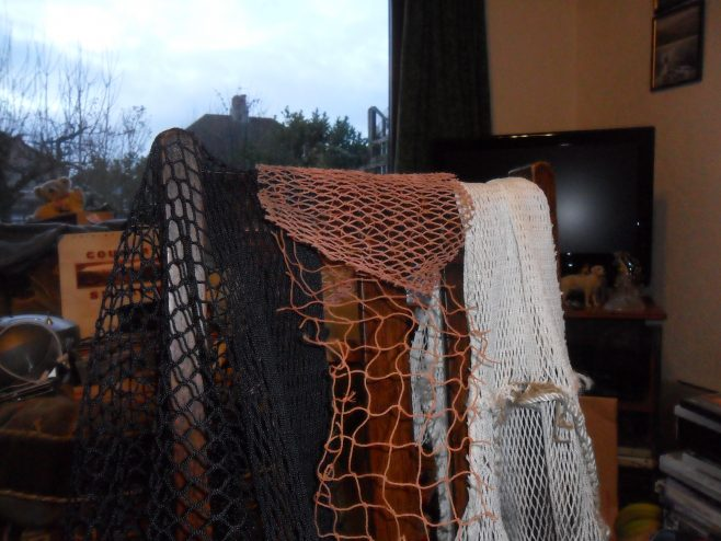 Close up of different types of fishing nets seen at the house of Ernie Nicholson, one of the oral history interviewees.