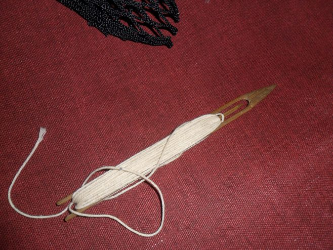A netting needle or shuttle loaded with twine seen at the house of Ernie Nicholson, one of the oral history interviewees.