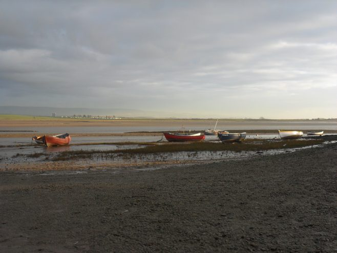 View of Lune estuary at Sunderland Point at low tide showing 6 small boats.
