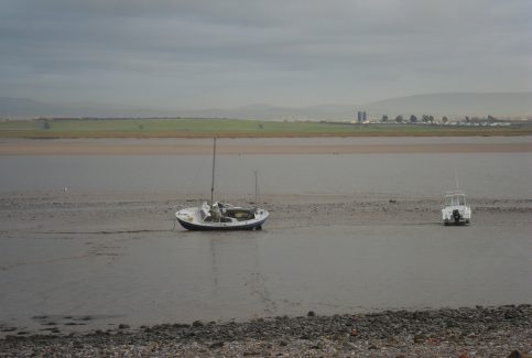 Two small fishing boats on the Lune estuary at Sunderland Point at low tide