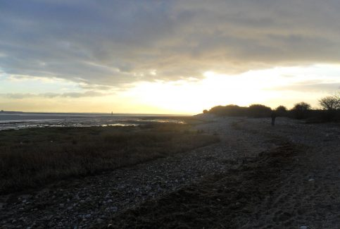 The rocky shore at Sunderland Point at dusk.