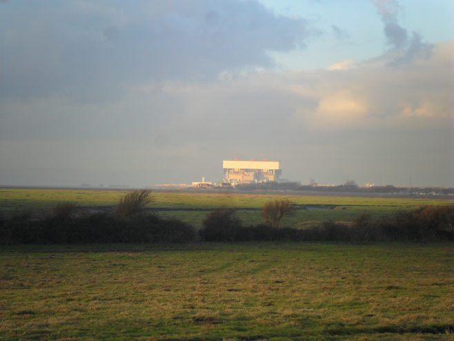 View of Heysham power station across the fields from Sunderland Point at sunset.