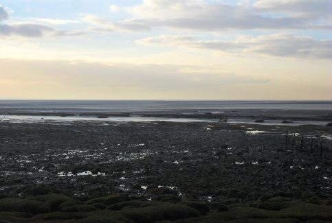 View of rocky shore and channel at Sunderland Point.