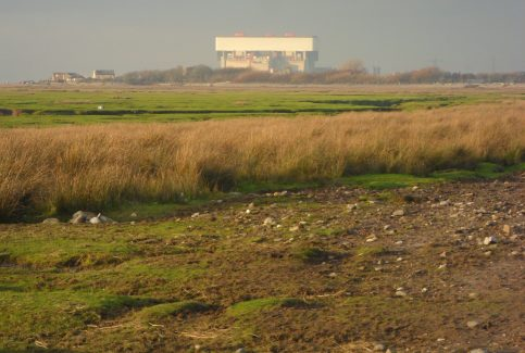 View of the shore at low tide to the west of Sunderland Point, with Heysham nuclear power station in the distance.