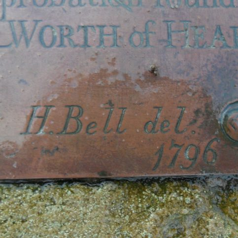 Close-up of a small section of plaque on Sambo's Grave at Sunderland Point showing some of the lettering on the grave marker, mainly the name H. Bell and the date 1796.