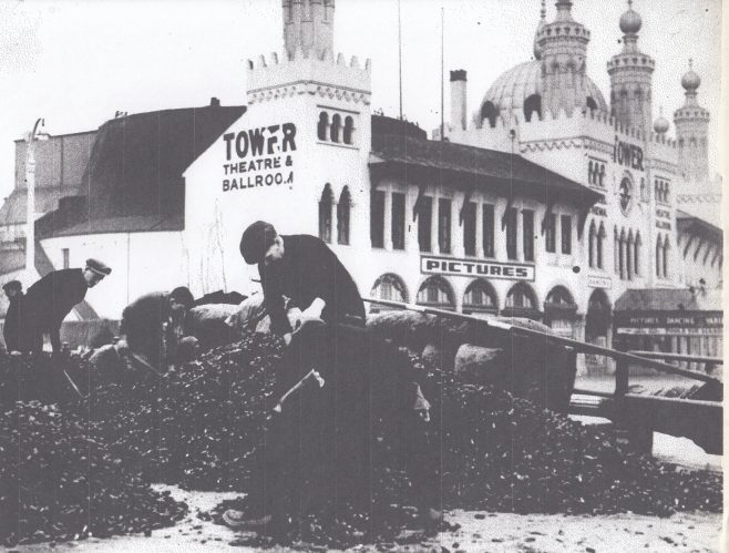 Sorting and bagging mussels on Morecambe promenade outside the Tower Theatre and Ballroom | Keith Willacy collection