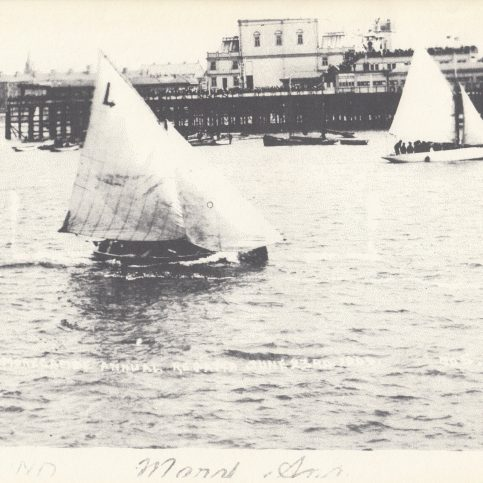 """Mussel boat """"Mary Ann"""" sailing in the annual Morecambe Regatta, with Central Pier in the background"""