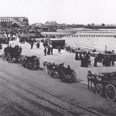 A view along Morecambe Promenade showing the landing stages of the pleasure boat companies.
