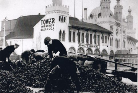 Sorting and bagging mussels on Morecambe promenade outside the Tower Theatre and Ballroom