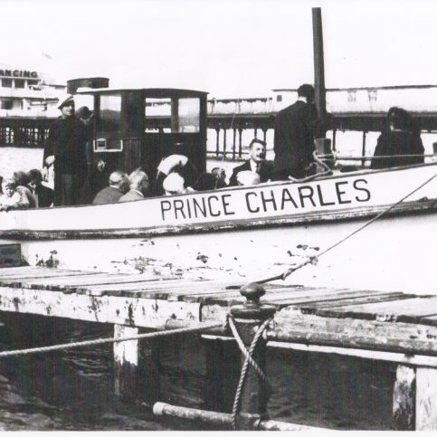 """Pleasure launch """"Prince Charles"""" taking on passengers alongside the Clock Tower stage"""