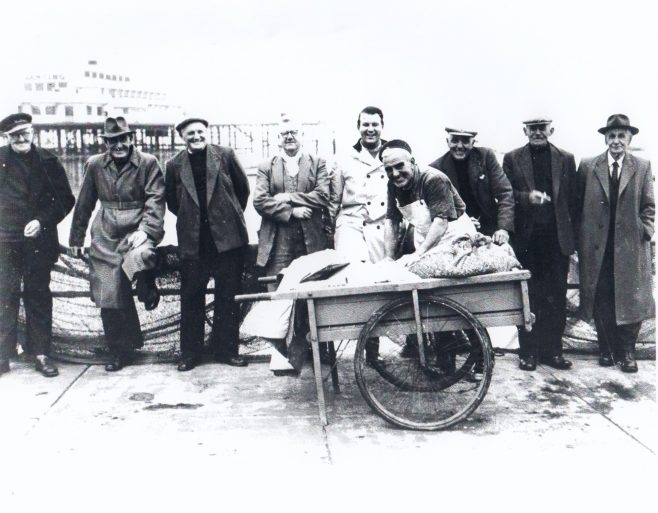 Morecambe fishermen pose for a photograph with Central Pier in the background | Keith Willacy collection