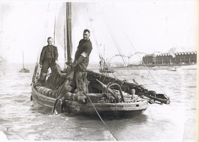 Ted and Bob (Parson Bob) Baxter pose for a photograph aboard