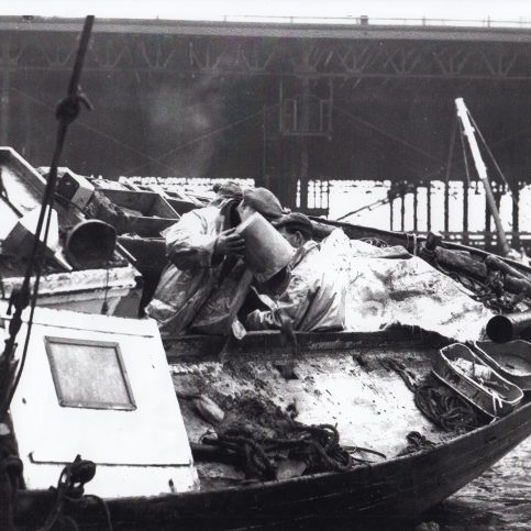 A Morecambe fisherman tending to his boat and catch