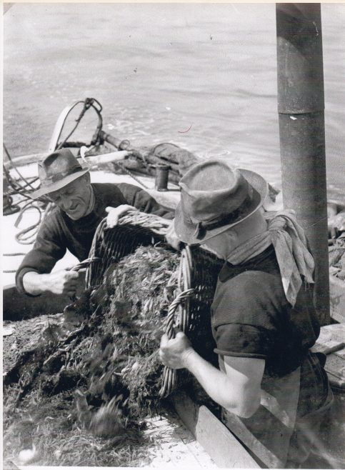 Two Morecambe Bay fishermen sorting their catch | Keith Willacy collection