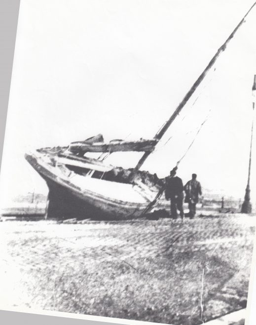A fishing boat aground at her moorings at low tide | Keith Willacy collection