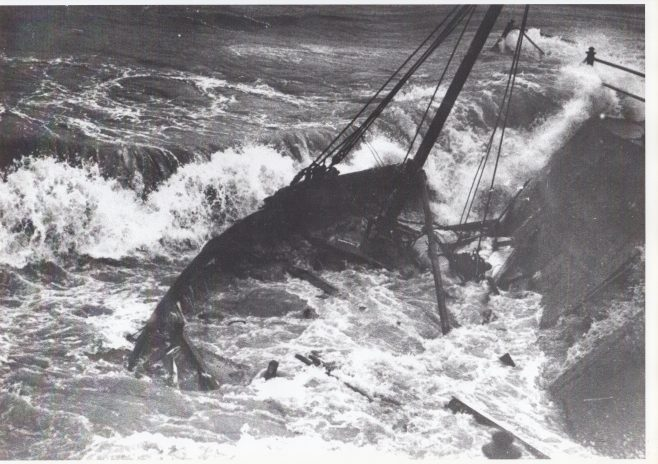 A swamped fishing boat being dashed aginst the promenade in a storm | Keith Willacy collection