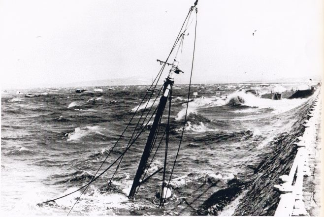 A sunken fishing boat up against the Promenade at Morecambe in a storm | Keith Willacy collection